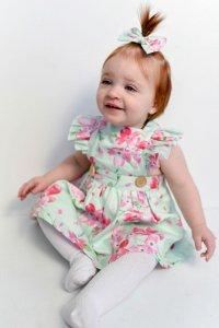 cute baby wearing charlotte flutter pinny