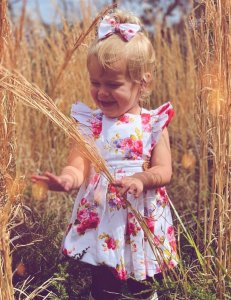 Baby girl wearing floral flutter dress