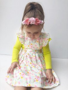 cute baby girl wearing phoebe pinny
