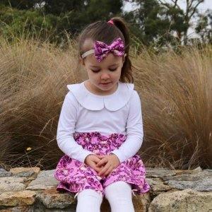 Baby girl wearing white peter pan top