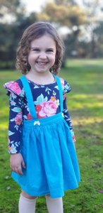 Beautiful baby girl wearing madison flutter dress