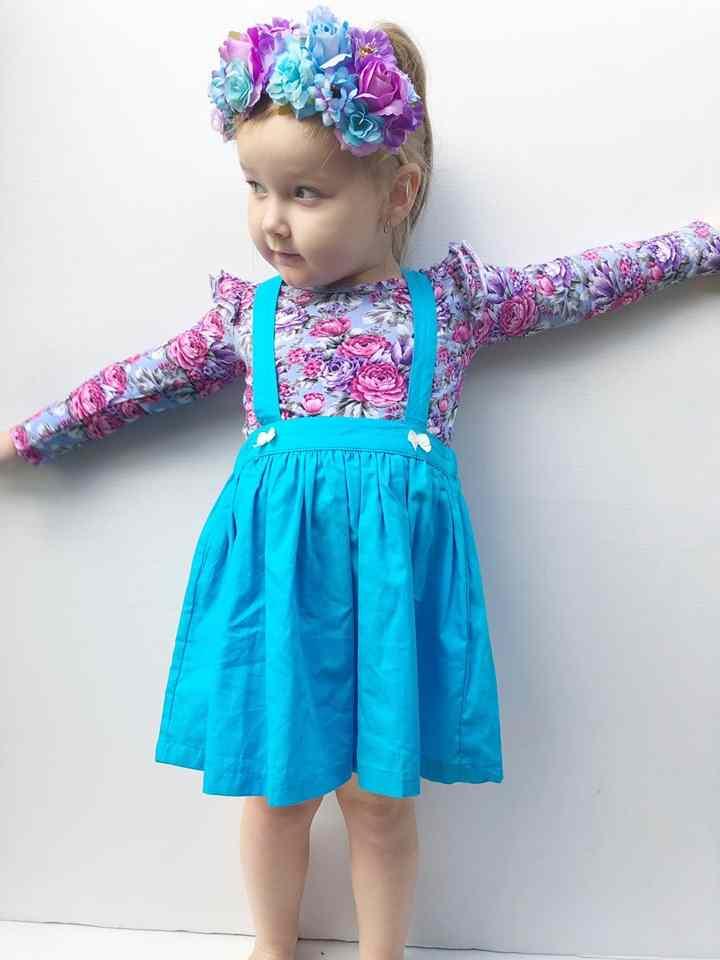 Toddler girl wearing Makayla Floral Flutter
