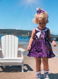 Little girl walking while on black currant skirt