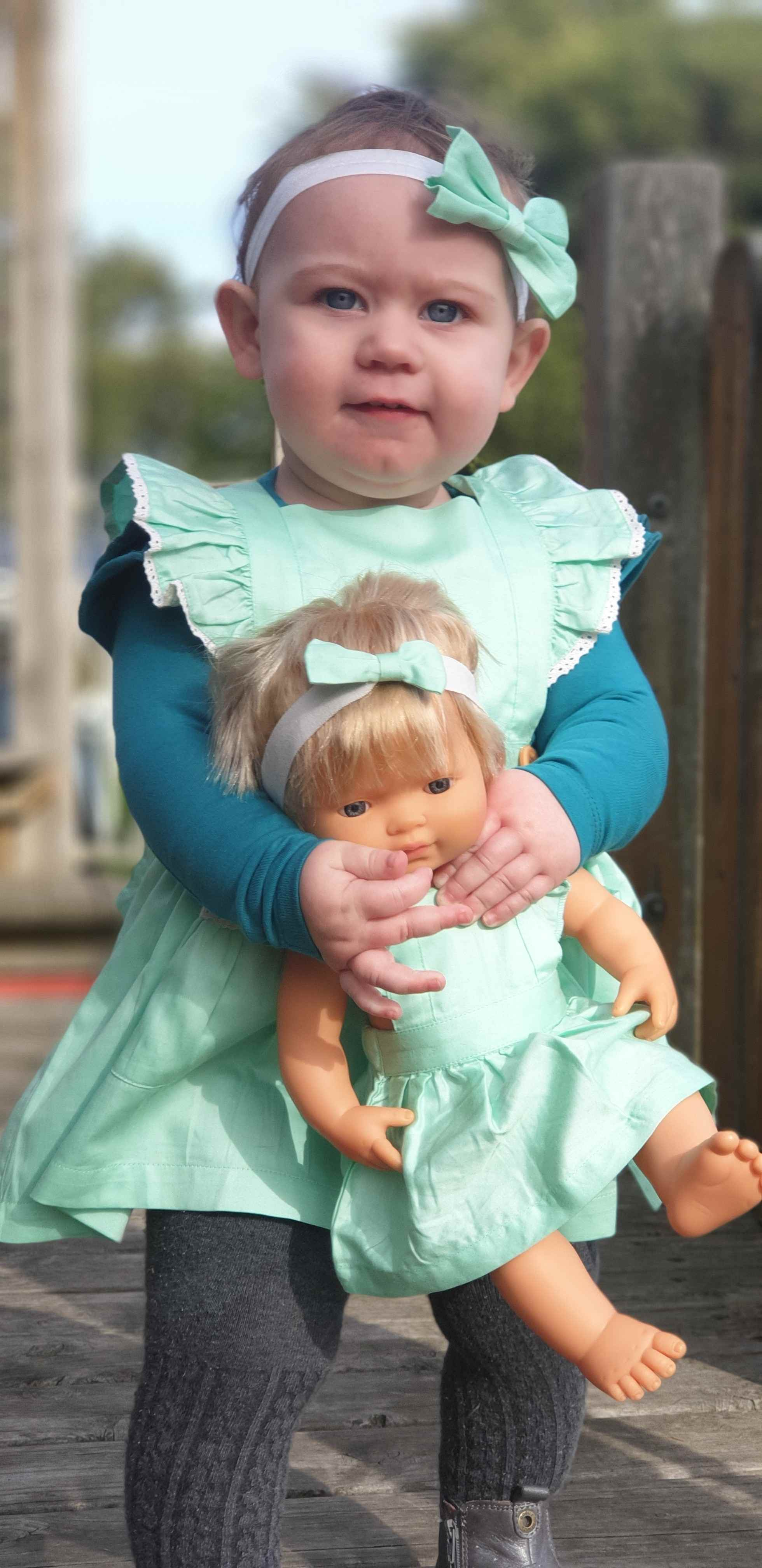 baby girl wearing teal Long sleeve Flutter dress