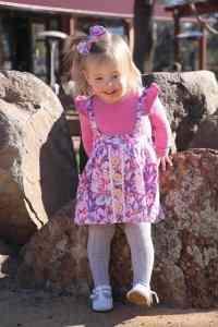 Toddler girl weraring aurora button skirt dress