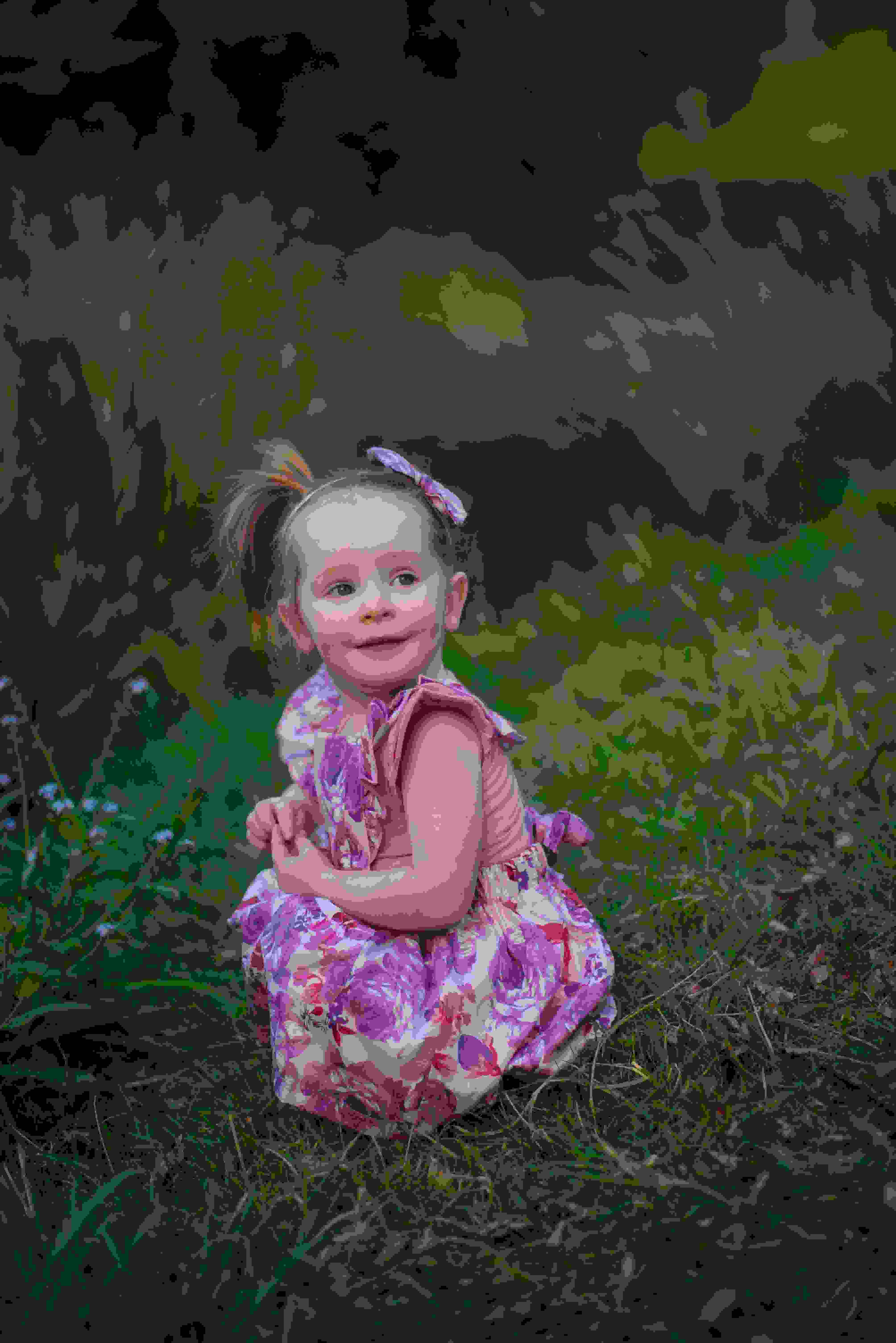 Cute baby girl posing while on ciara flutter pinny dress