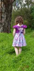 Baby girl wearing Navy colour bow back flutter