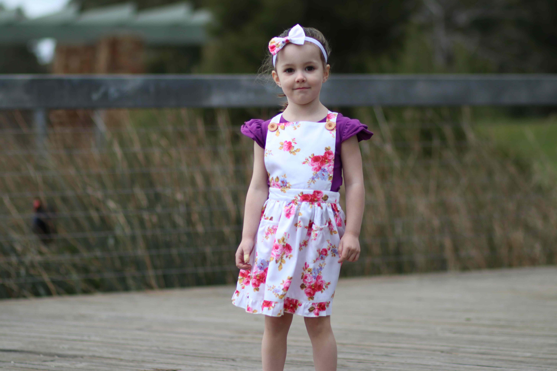 Cute girl wearing florence frill pinny dress
