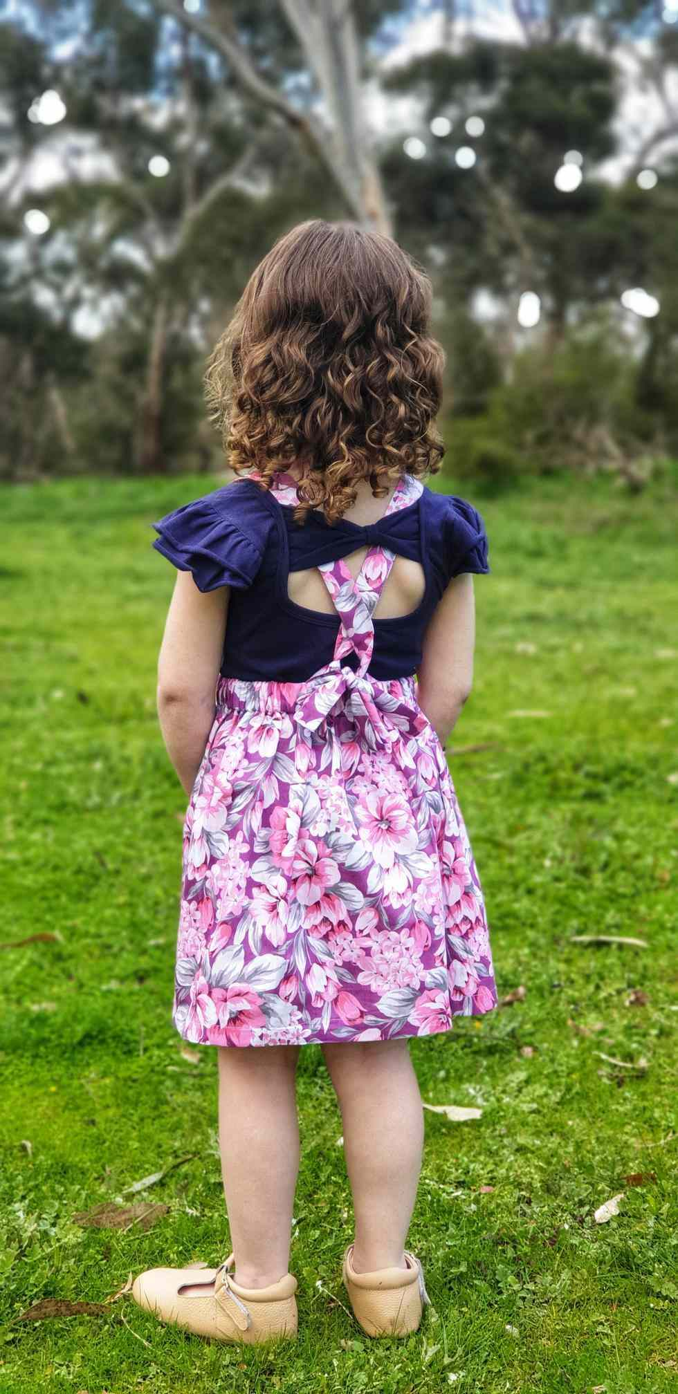 Baby girl wearing Navy colour bow back flutter
