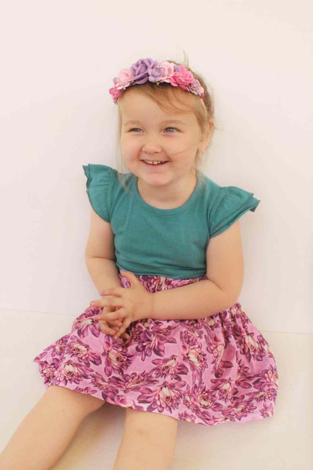 Cute girl wearing sleeveless flutter