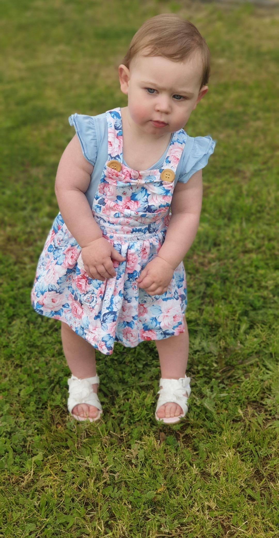 Cute baby girl wearing sky blue flutter dress