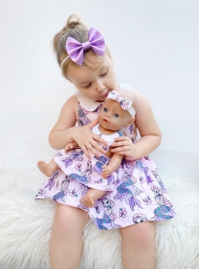 Gorgous girl with her dolly