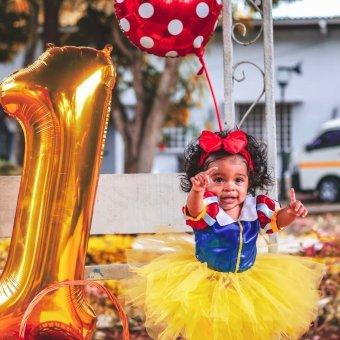Cute girl posing in-between her birthday celebration