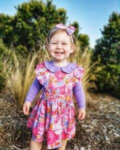 cute girl in flutter pinny