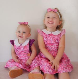 Gorgeous sisters matching in floral pinny