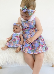 Girl and her matching in unicorn pinafore