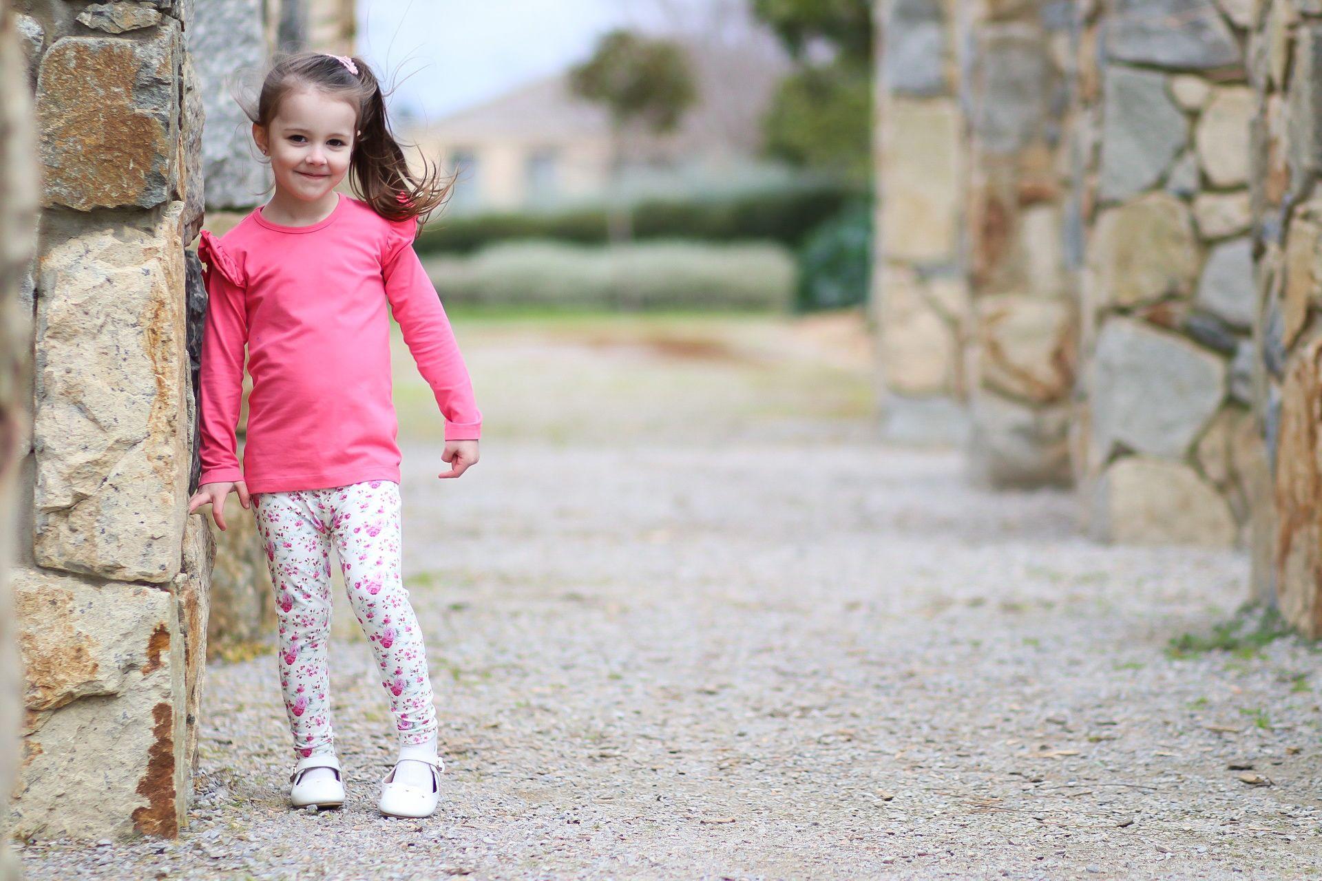 Cute girl wearing floral leggings