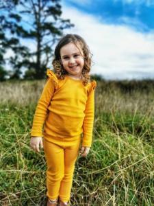 Gorgeous girl wearing mustard flutter