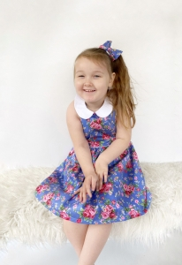 Beautiful girl wearing pinafore