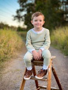Handsome boy wearing Sage jumper