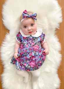 Newborn in collar dress