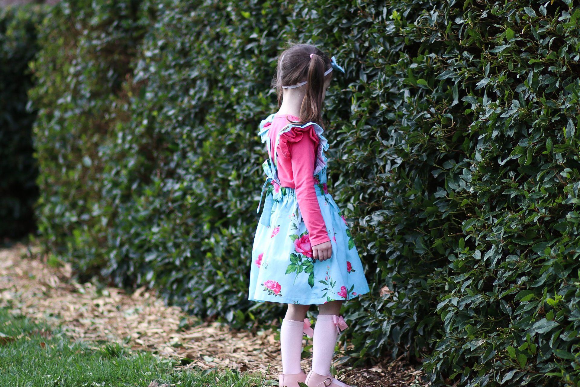 Gorgeous girl in flutter pinny