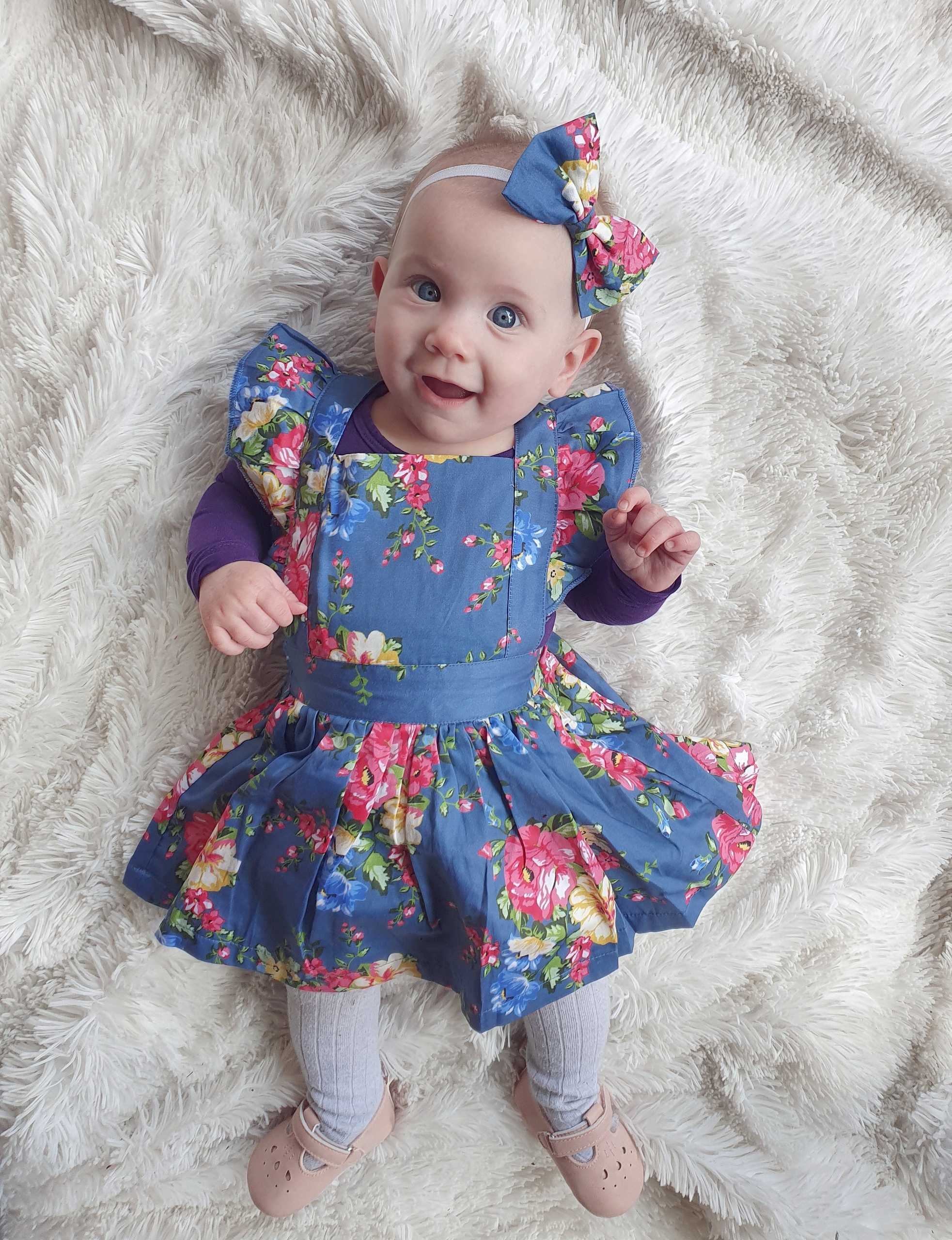 Toddler baby wearing flutter pinny
