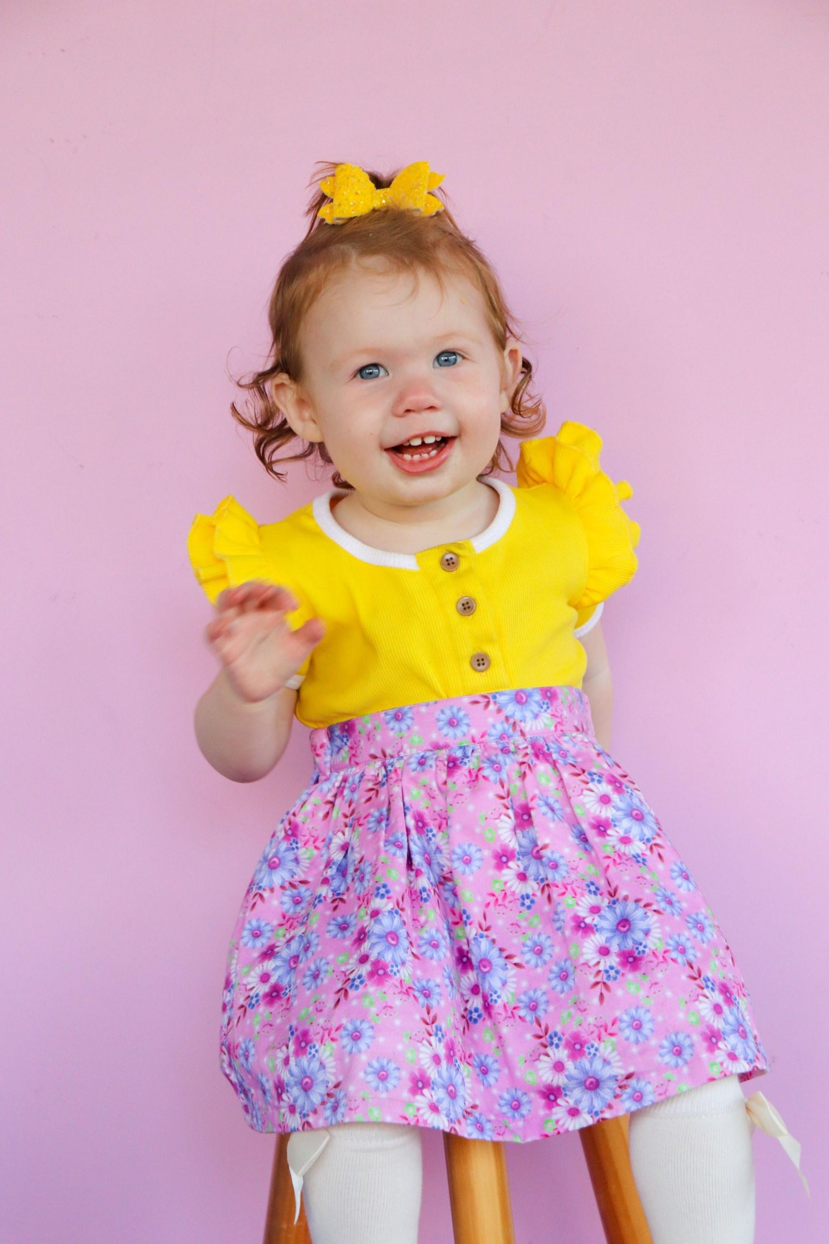 Cute girl wearing suspender skirt