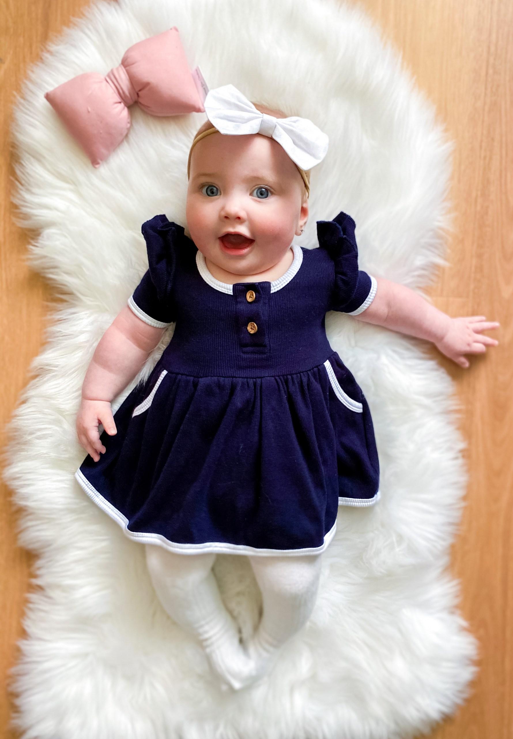 Cute girl in Navy dress
