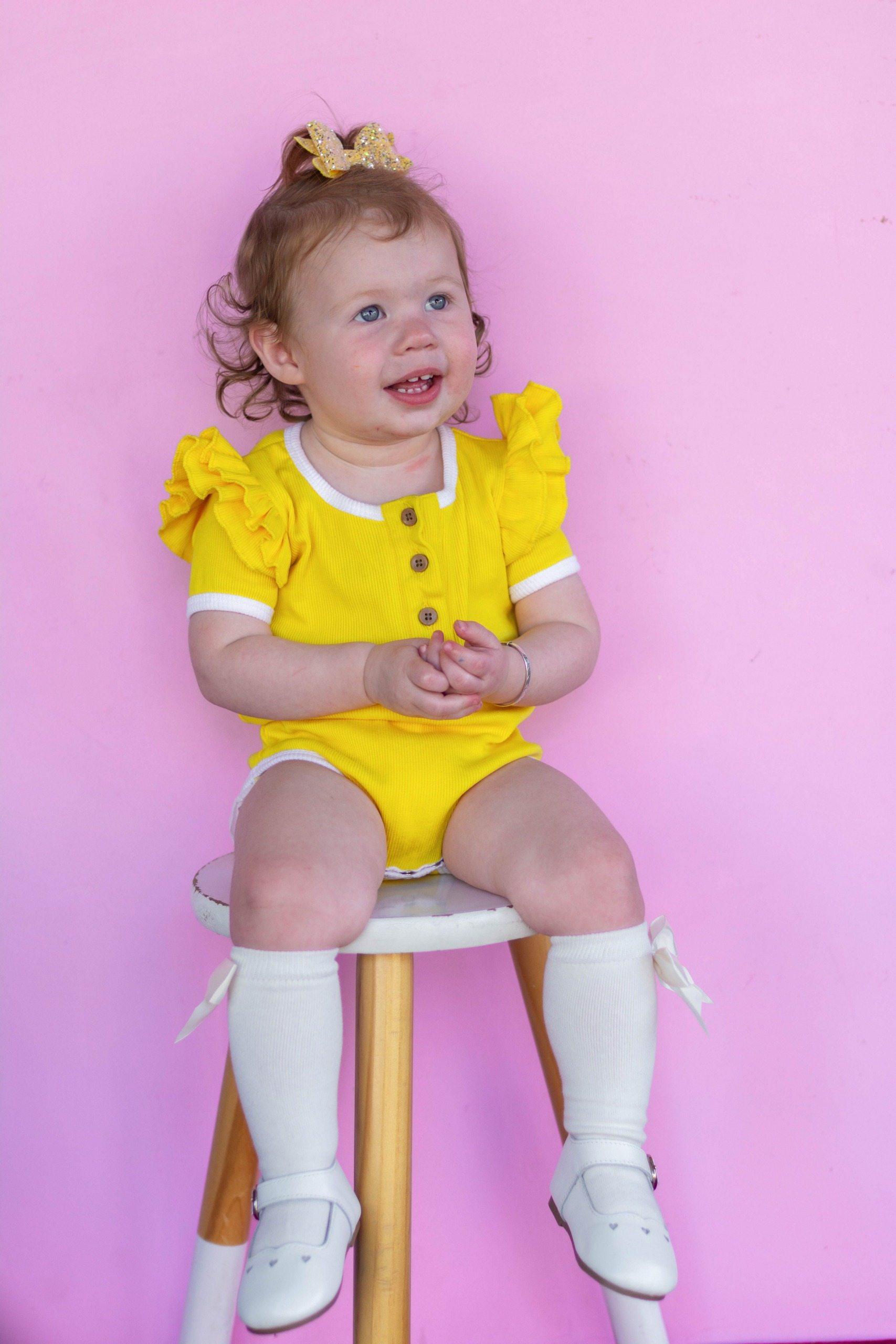 Beautiful girl in yellow top