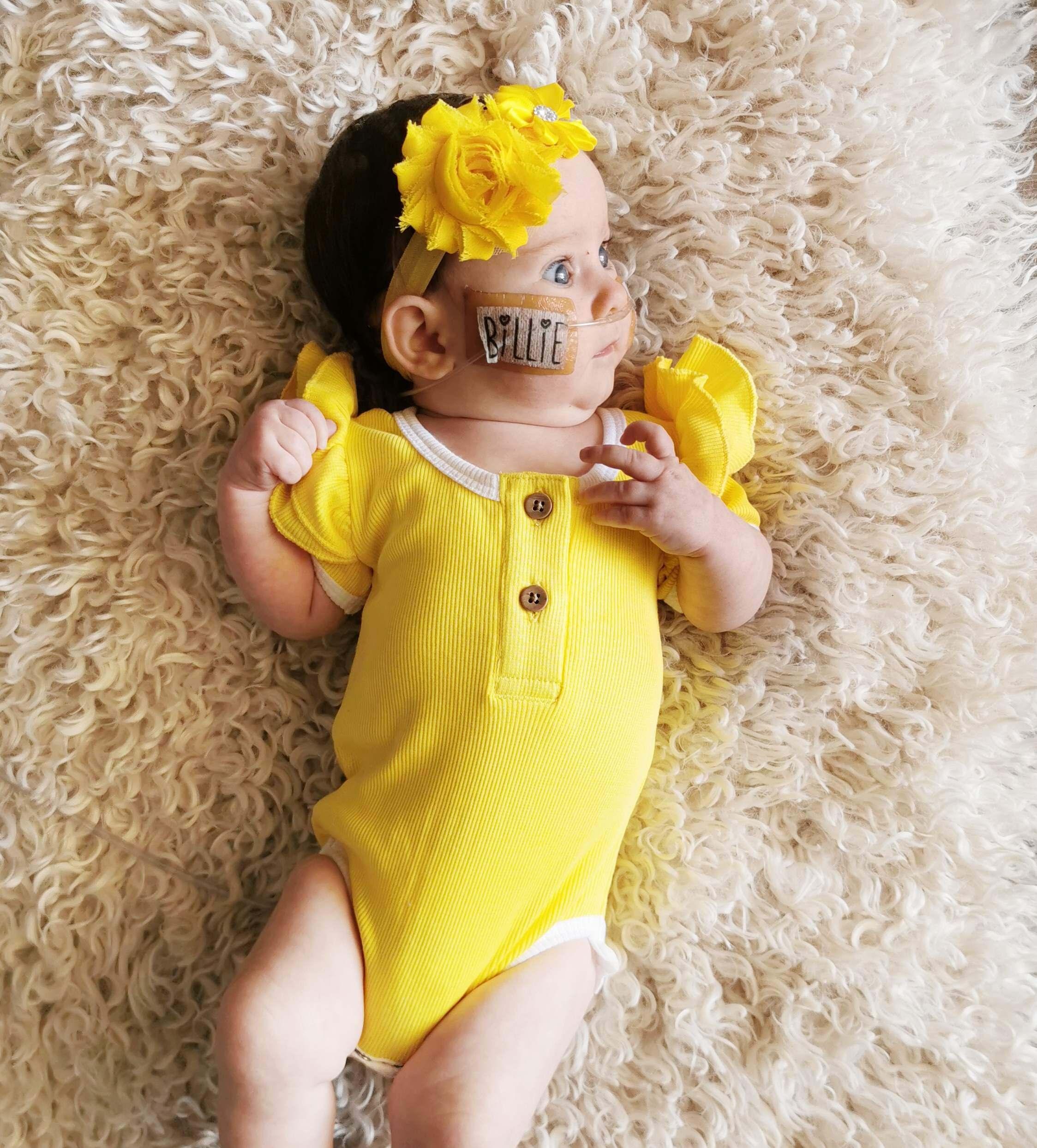 new born girl in yellow top
