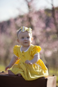 Baby girl in yellow dress