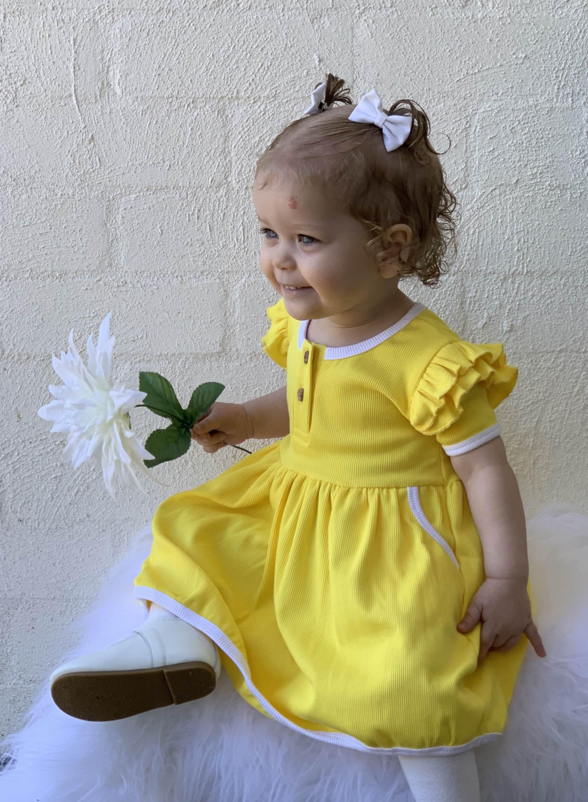 Cute girl in yellow dress