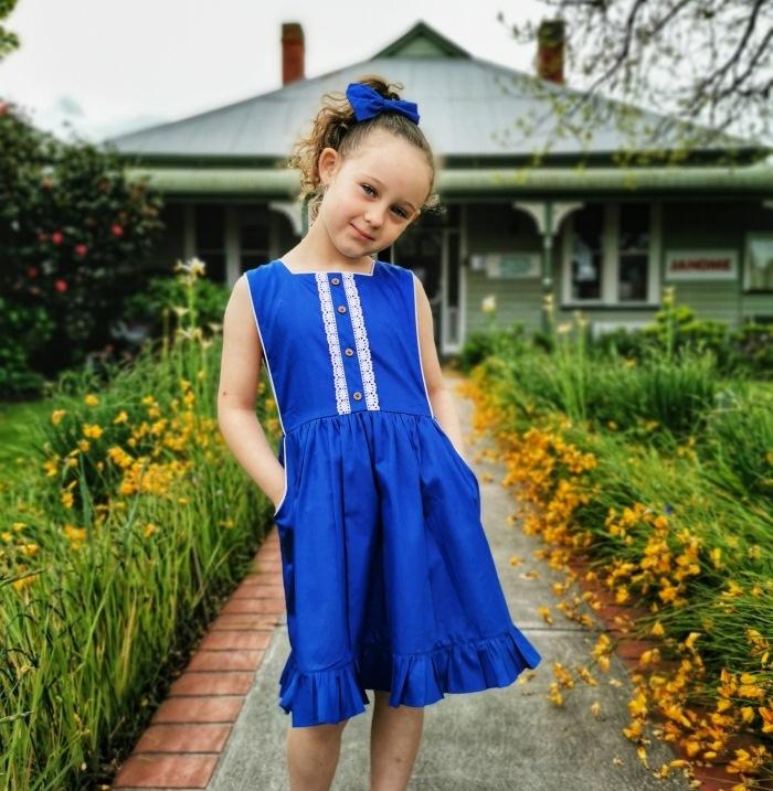 Royal blue button bib dress for girls