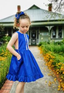 Girl in bib dress