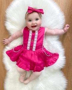 Newborn girl in pink dress