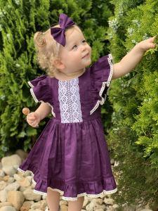 Baby girl in ruffles dress