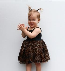 Cute girl in leopard dress