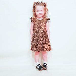 Gorgeous girl in leopard dress