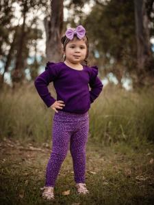 Cute girl in leopard leggings