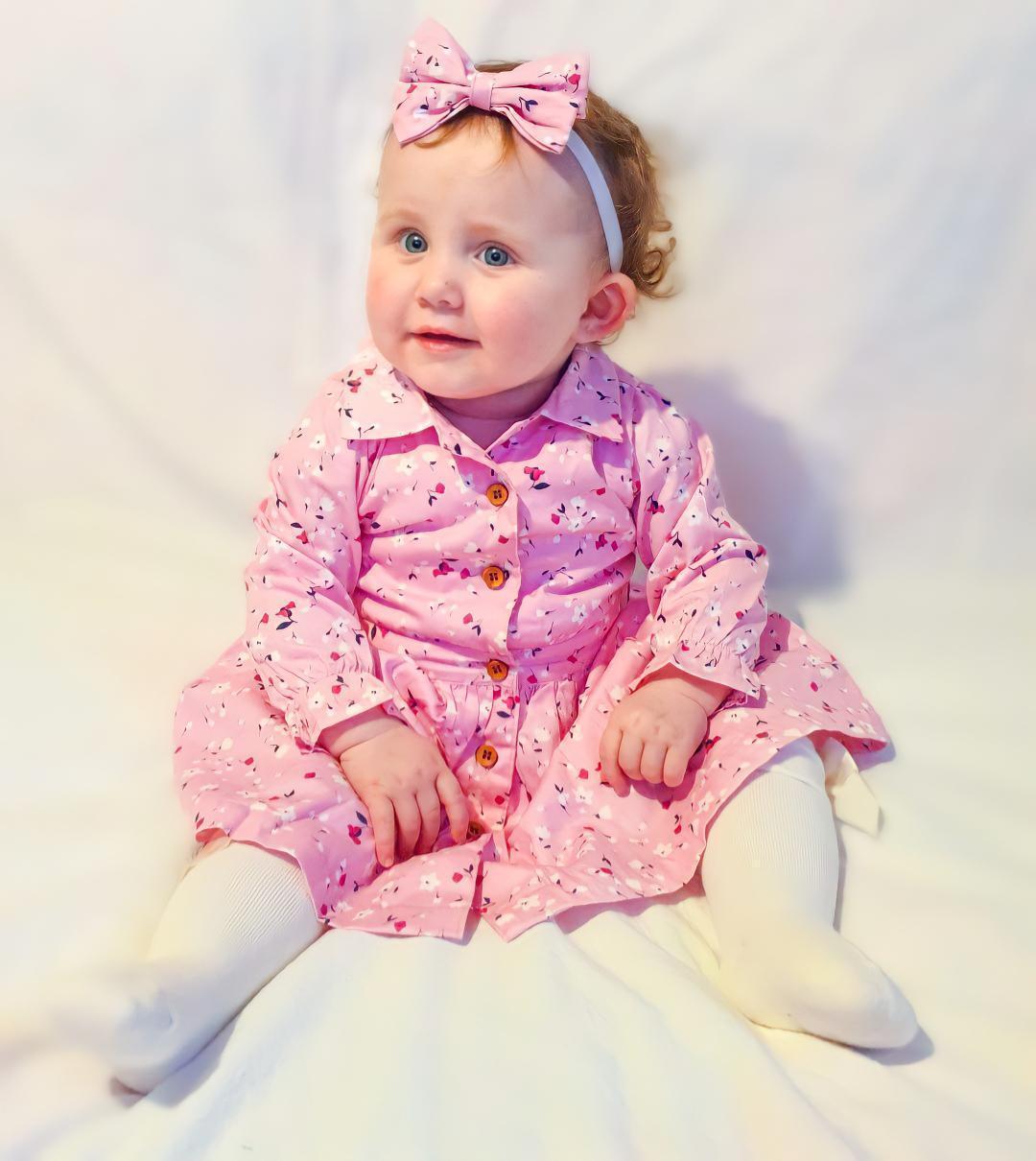 Baby girl in cute dress