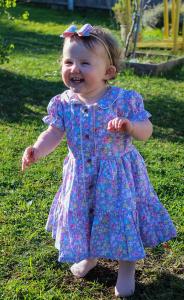 Baby in purple dress