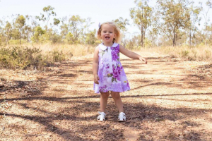 Baby girl in pretty dress