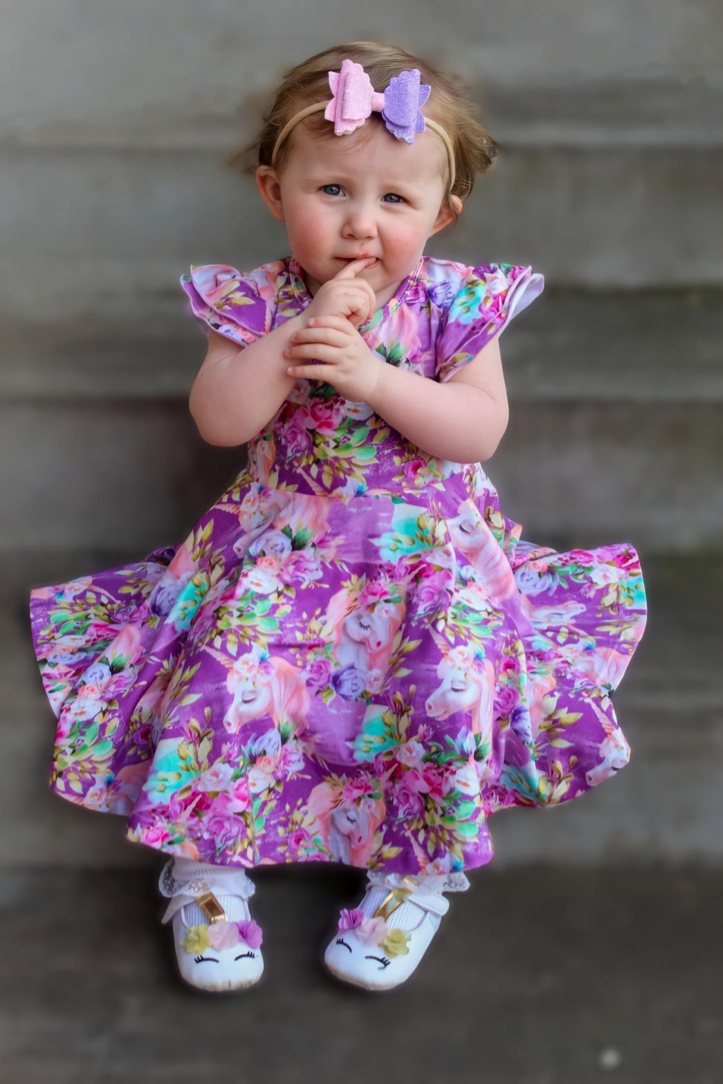 little girl in unicorn dress